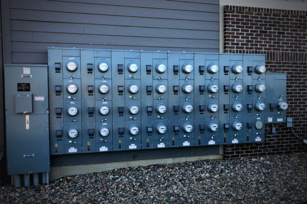 Meter boxes on the outside of a multi-family home complex.